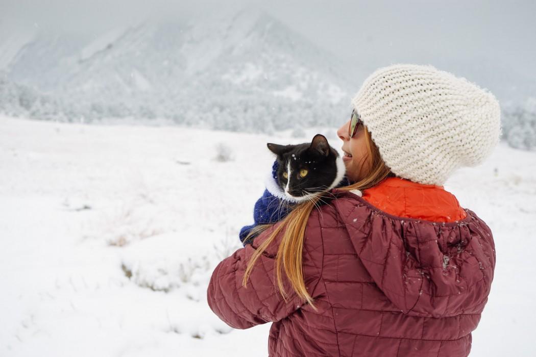 Erin Verplaetse snuggling cat on snowy day
