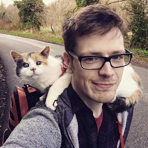 Patrick Corr and his cat Stevie on backpack