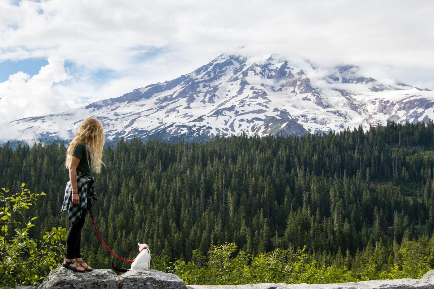 woman hiking with cat