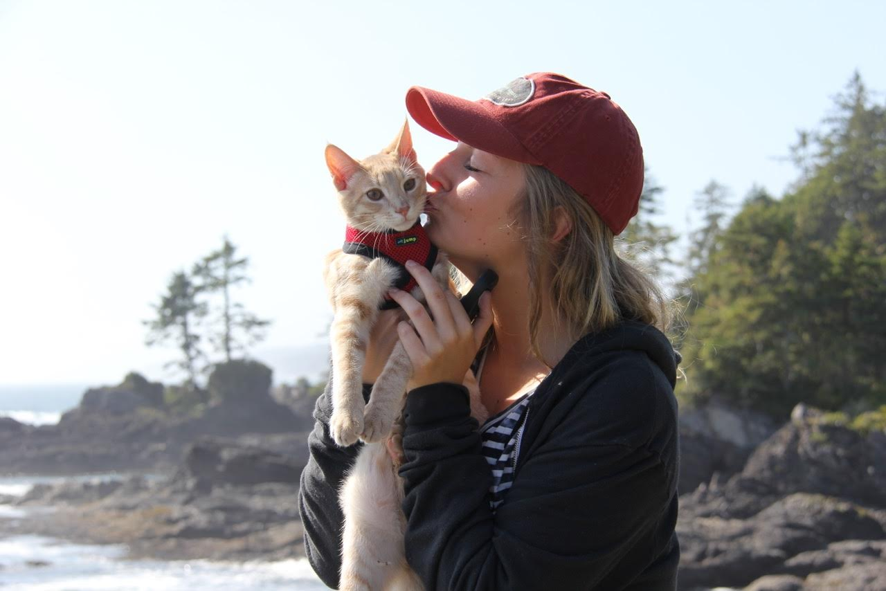 woman kissing pet cat