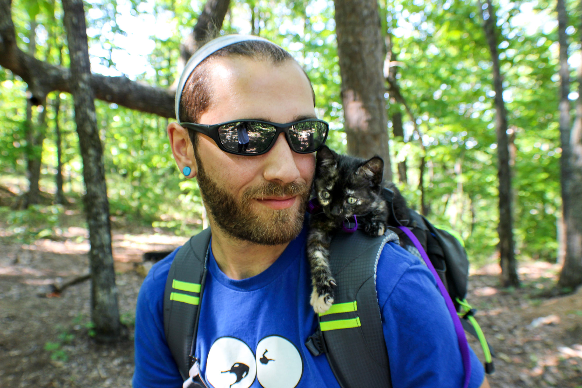 Ryan Mallon hiking with kitten