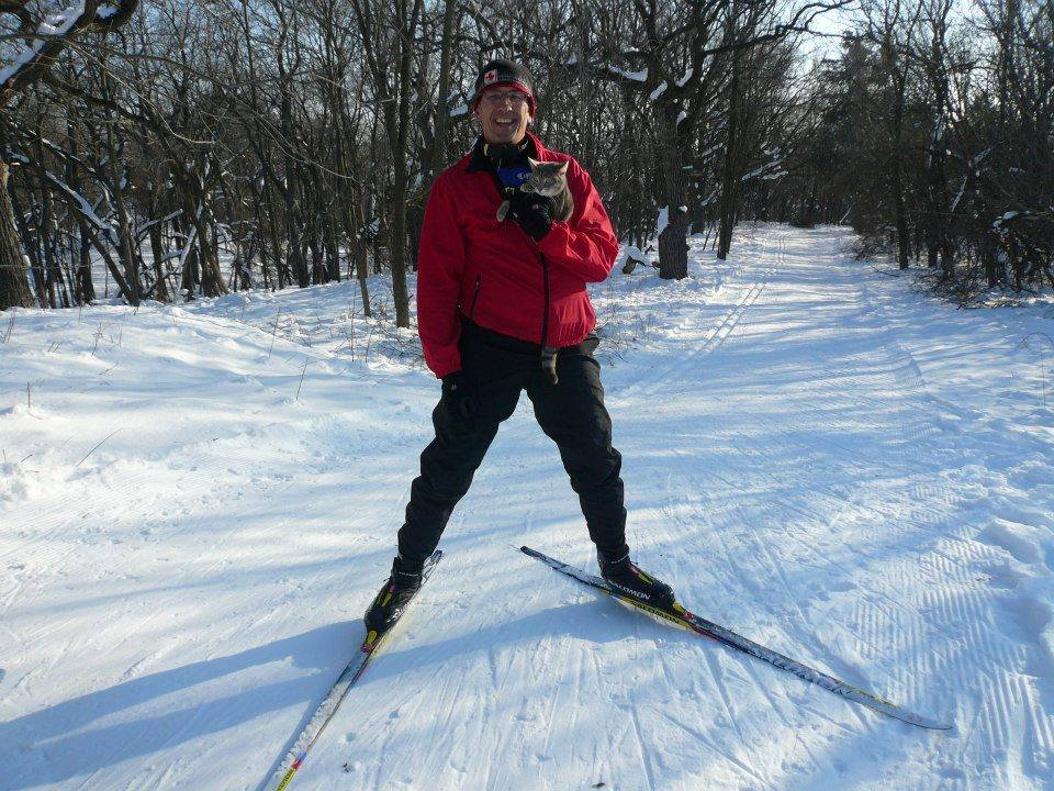 veterinarian skiing with cat