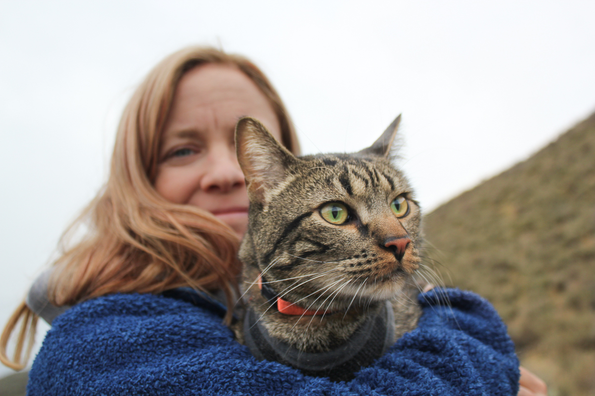 Woman holds cat