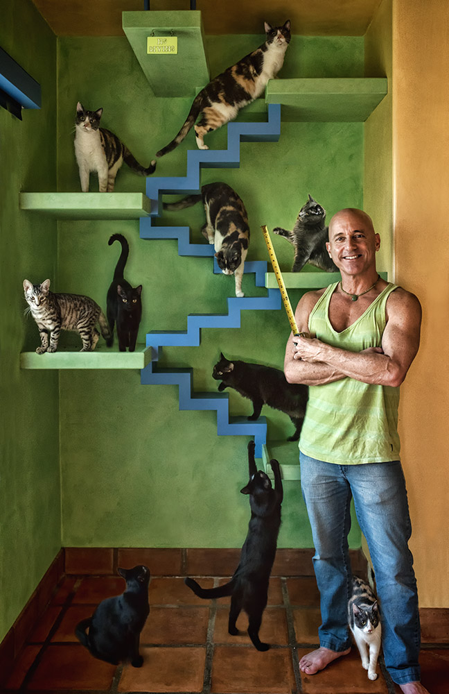 Peter Cohen with tape measurer and cats