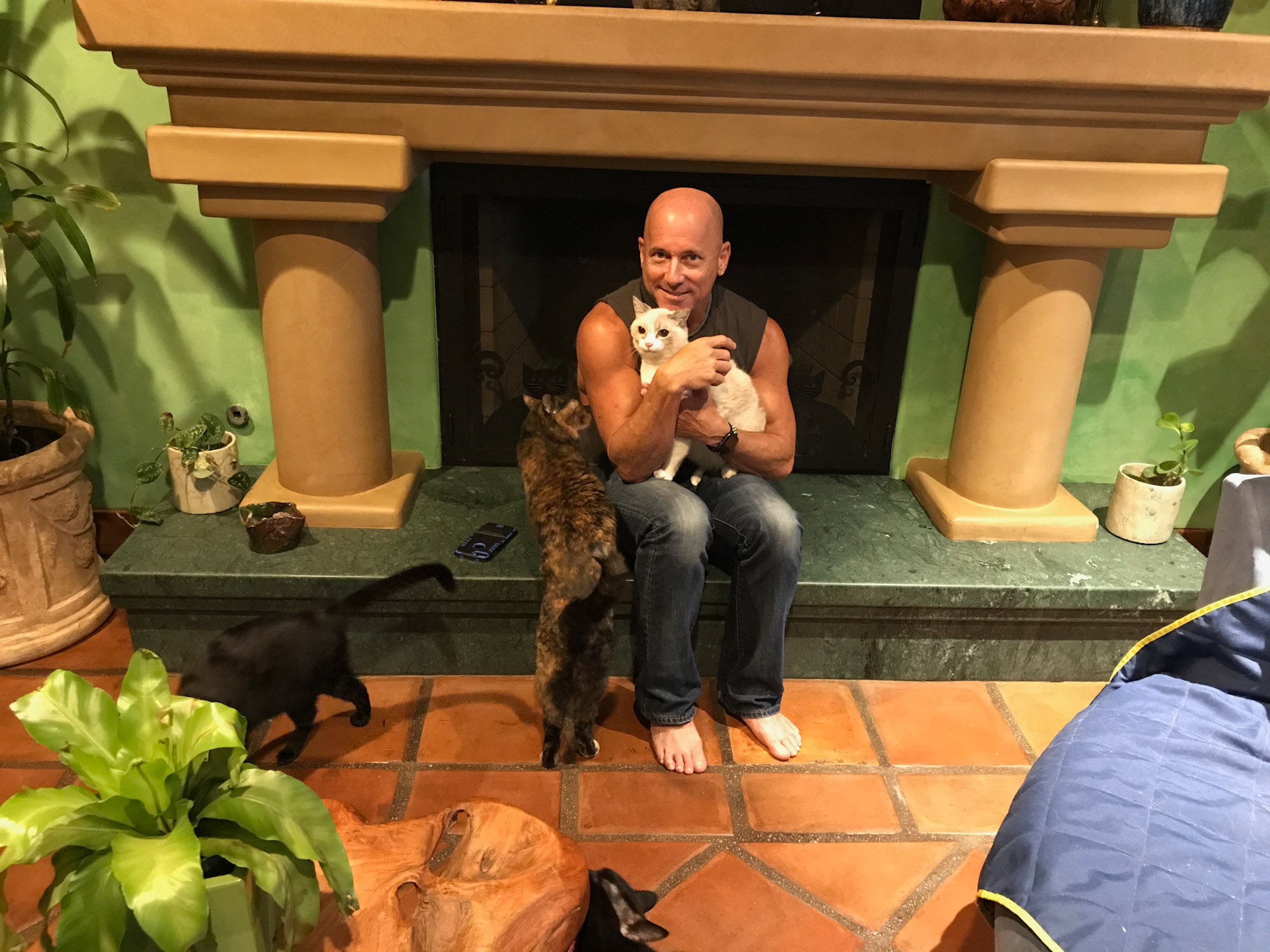 Peter Cohen holding cats