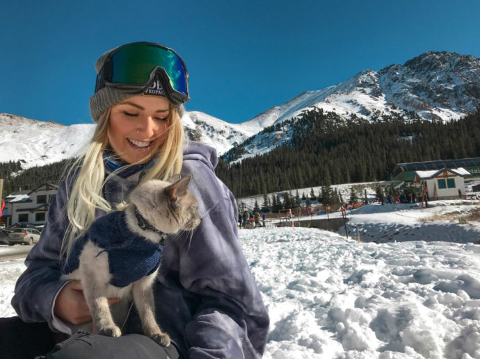 Alexis Hinkley and adventure cat Tuna in snow