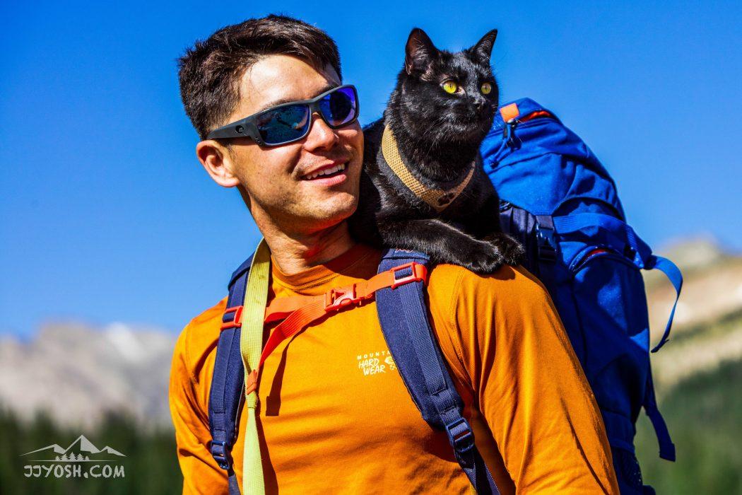 Simon riding on JJ's backpack