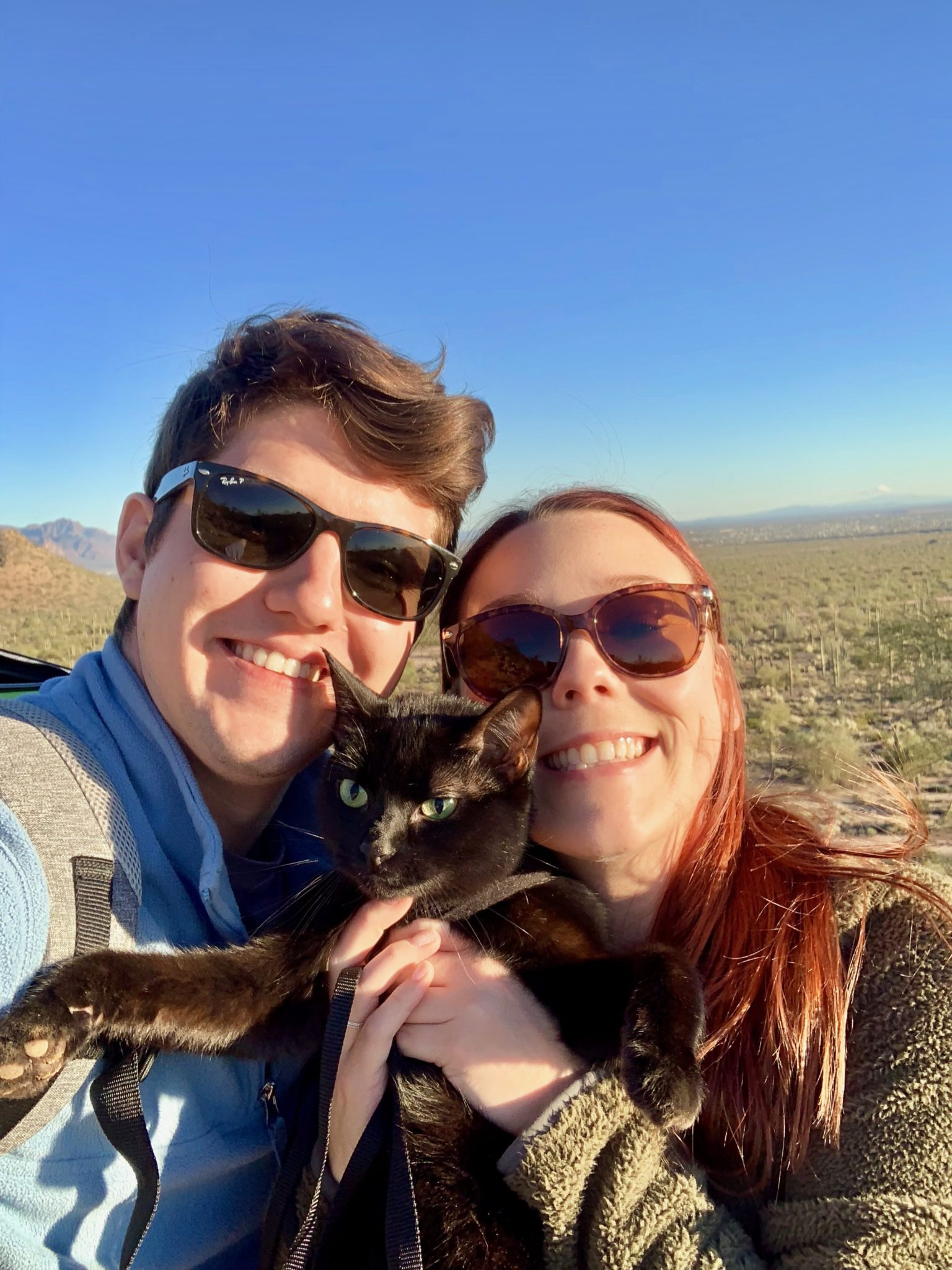 Cash the adventure cat with his humans